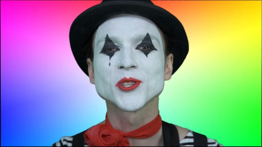 The face of a condescending talking mime surrounded by colours