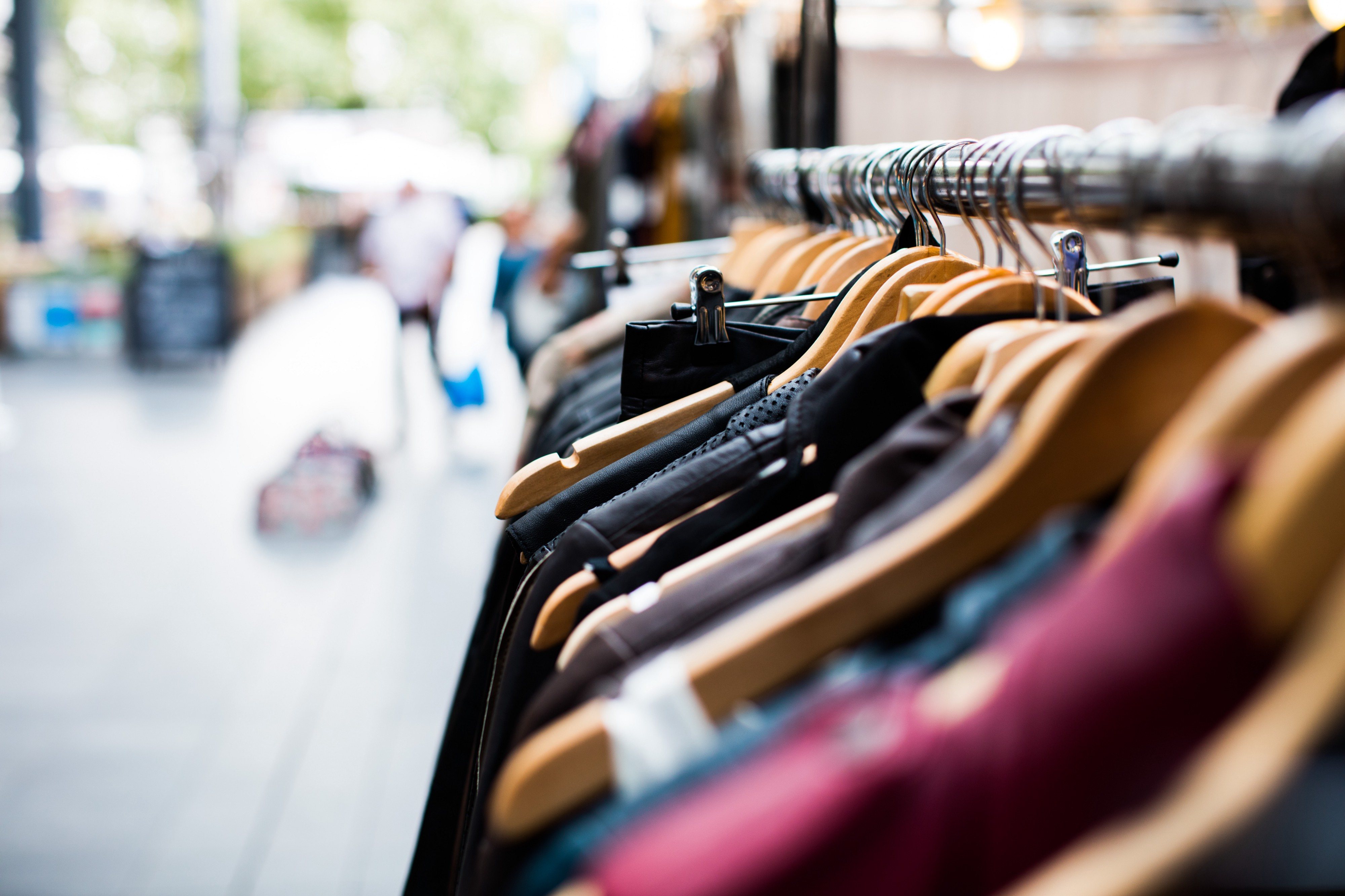 Rails of clothing for sale in an open market place