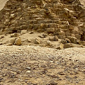 A tight crop of a pyramid that looks like a pile of bricks.