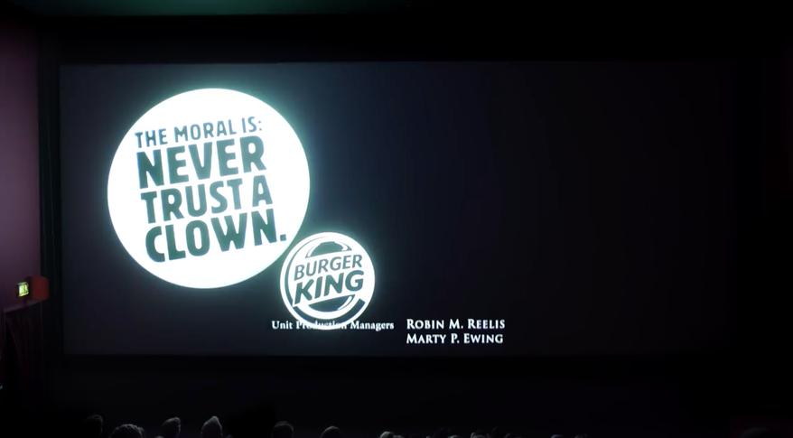 """The moral is: Never trust a clown"" next to a Burger King logo on the cinema screen"