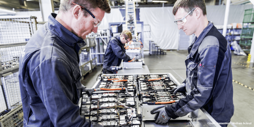 Workers dismantling a battery