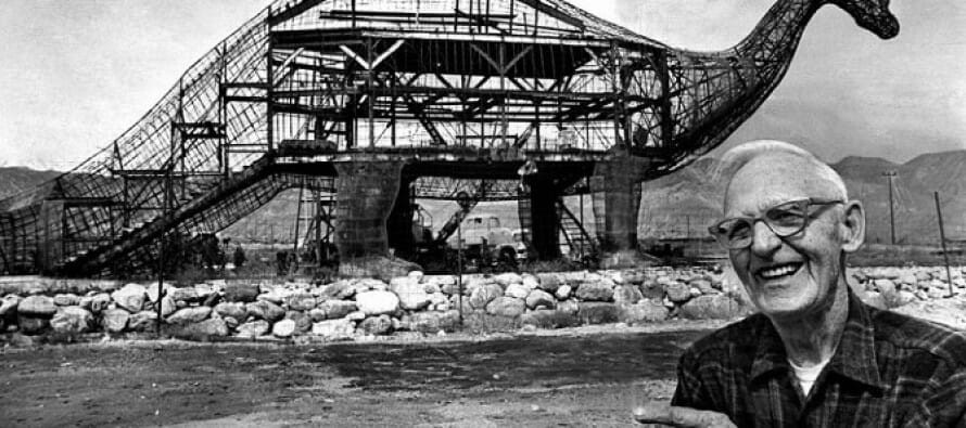 Claude Bell, the builder, stands in front of the framework for Dinny the Dinosaur.