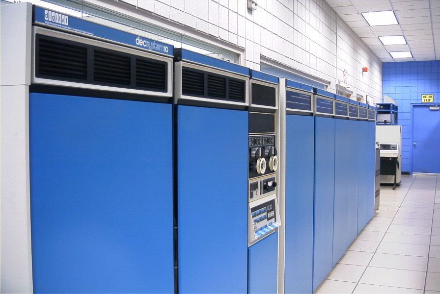 An old mainframe computer modules roughly the size of refrigerators, stacked next to each other in a lab, that housed CPUs.