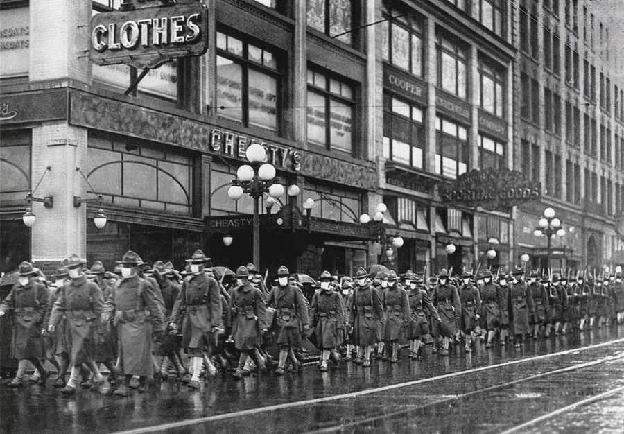 The U.S. Army 39th regiment wear masks to prevent influenza in Seattle in December of 1918. The soldiers are on their way to