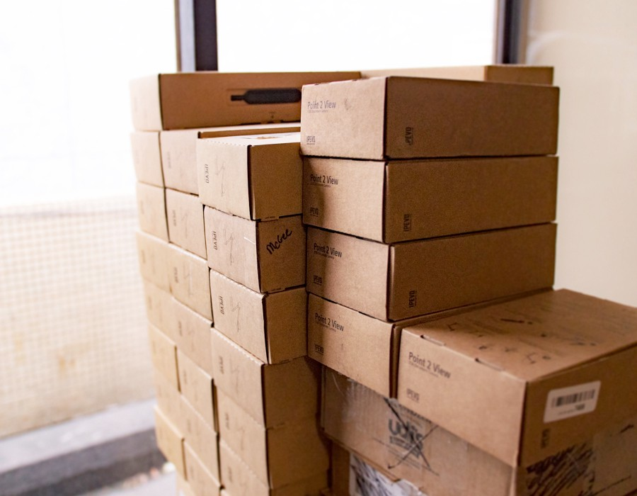 Pooled returned document cameras stacked up in our warehouse.