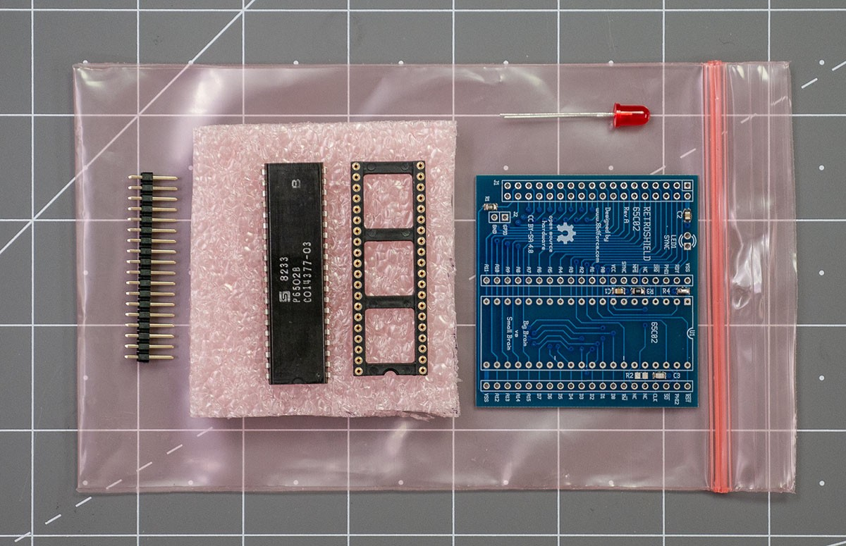 Kit Contents for the RetroShield6502, it is a pcb, processor, socket, and header