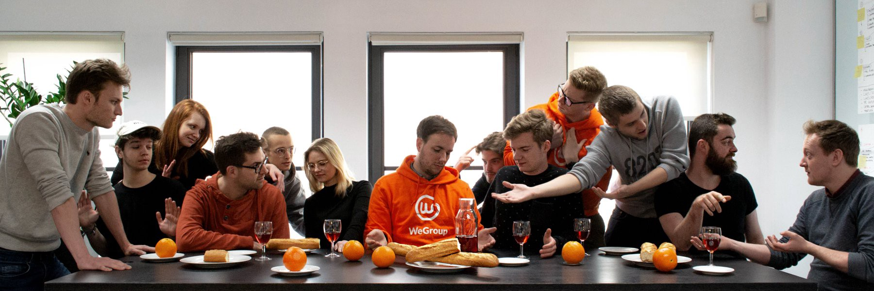 The WeGroup team, with a parody on the last supper