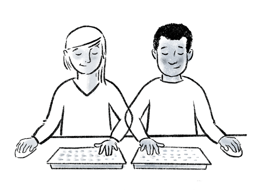 Two people sit side by side, completing the same task on two screens and mirroring each other's actions as they go along.
