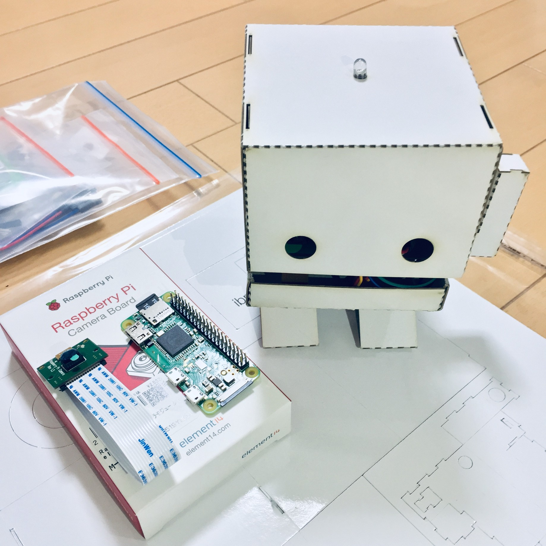 TJBot Zero, a cardboard robot using AI technologies