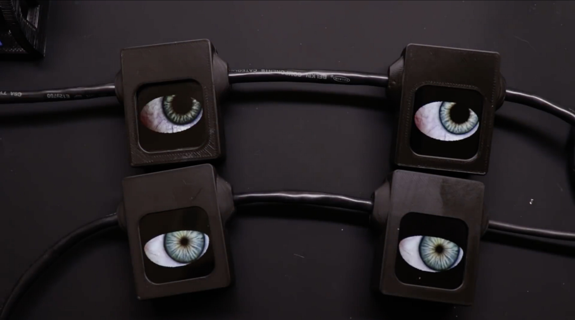 Chain of Animated Eyes Blink Creepily from Hiding - Hackster Blog