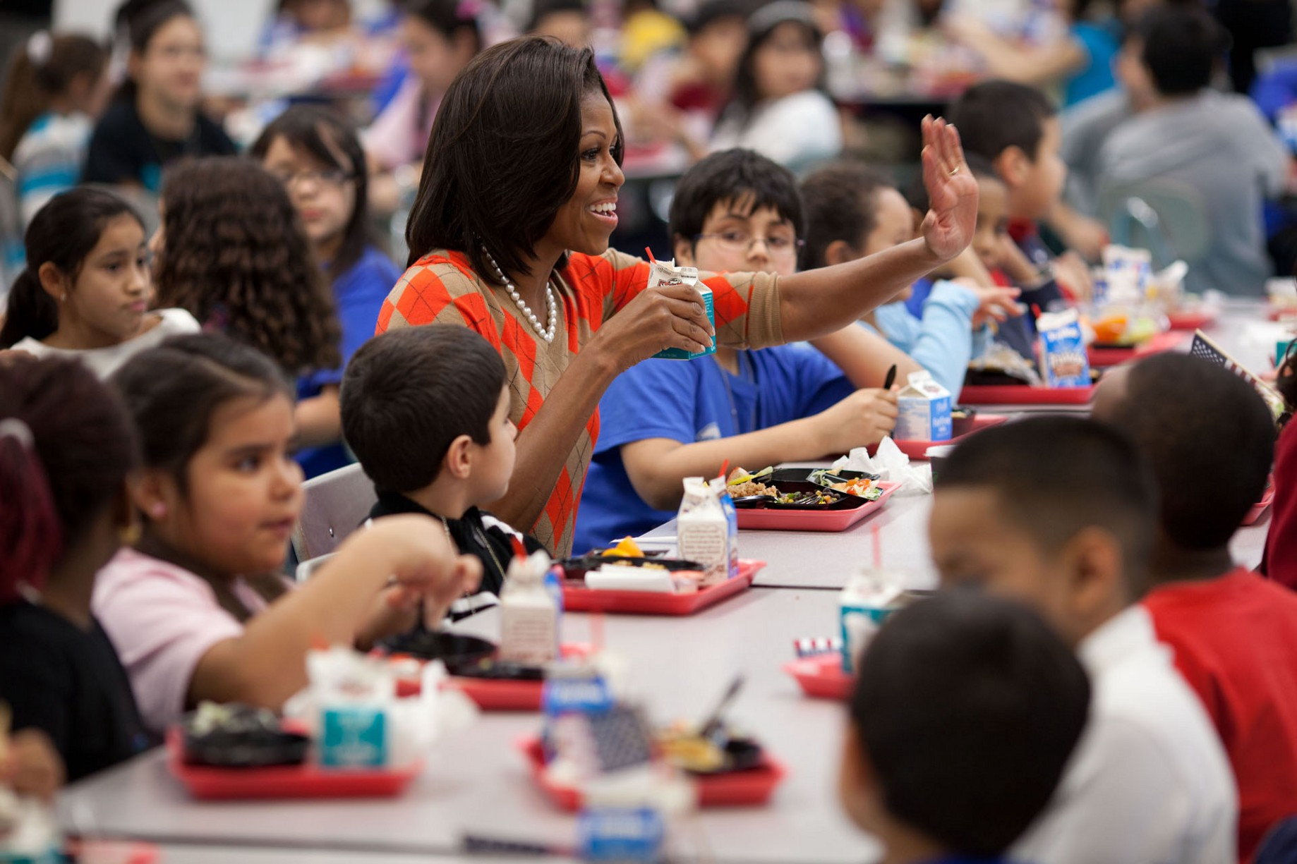 Image result for michelle obama teachings kids how to eat