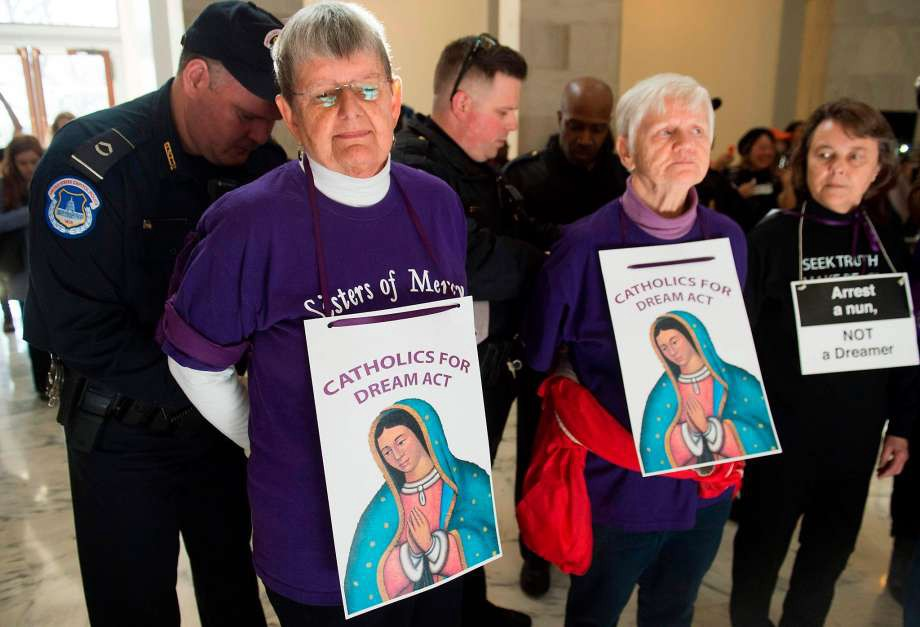 """U.S. Capitol Police arrest Catholic nuns rallying in the Senate office building to support recipients of Deferred Action for Childhood Arrivals, or """"Dreamers."""" Photo: SAUL LOEB, AFP/Getty Images"""