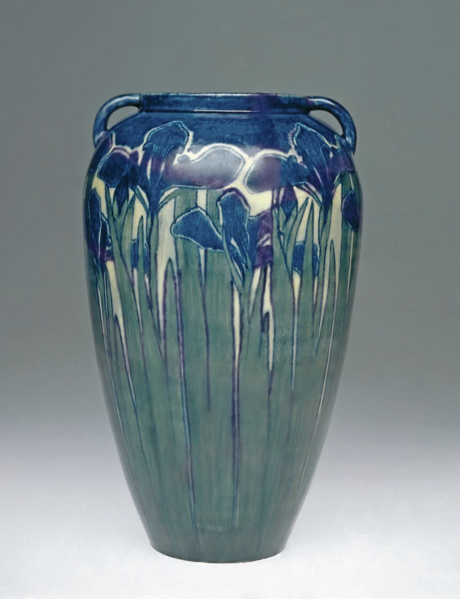 Large ceramic vase decorated with tall grasses and irises.