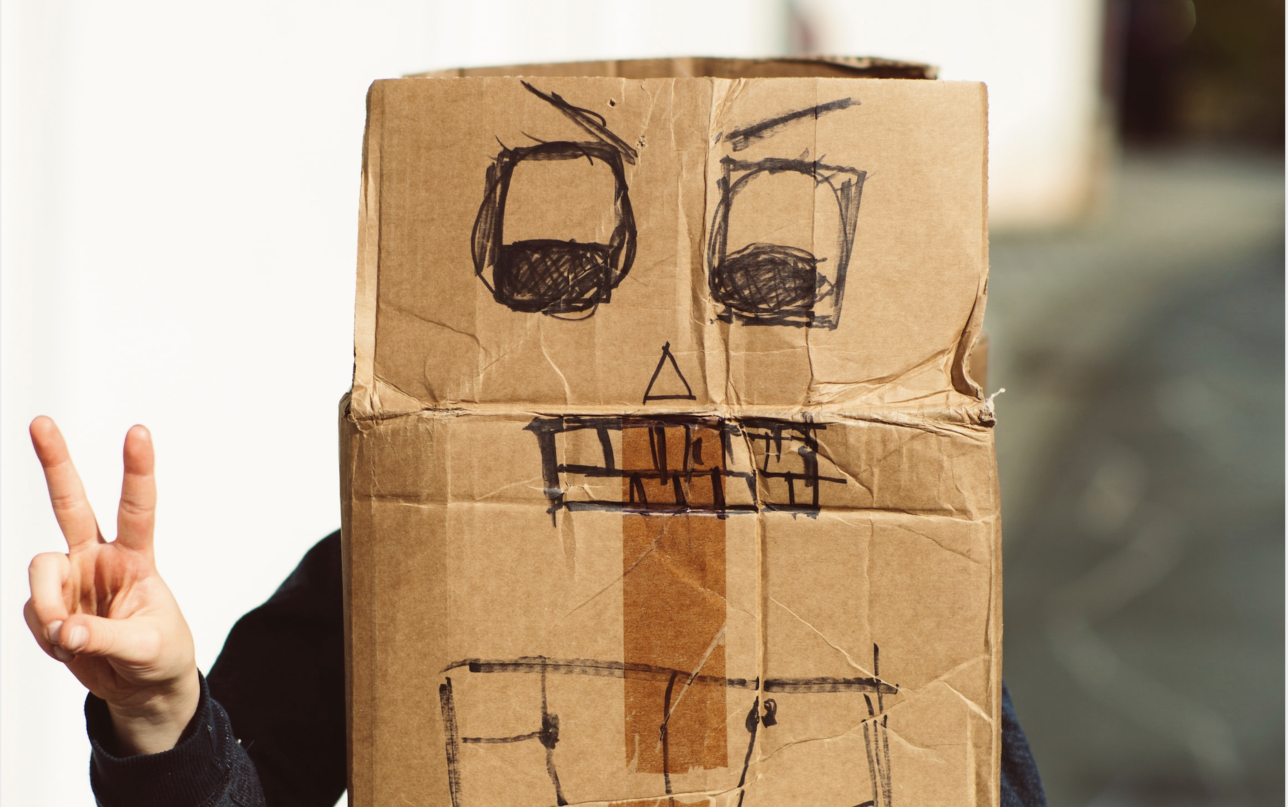 boy making a costume from a cardboard box