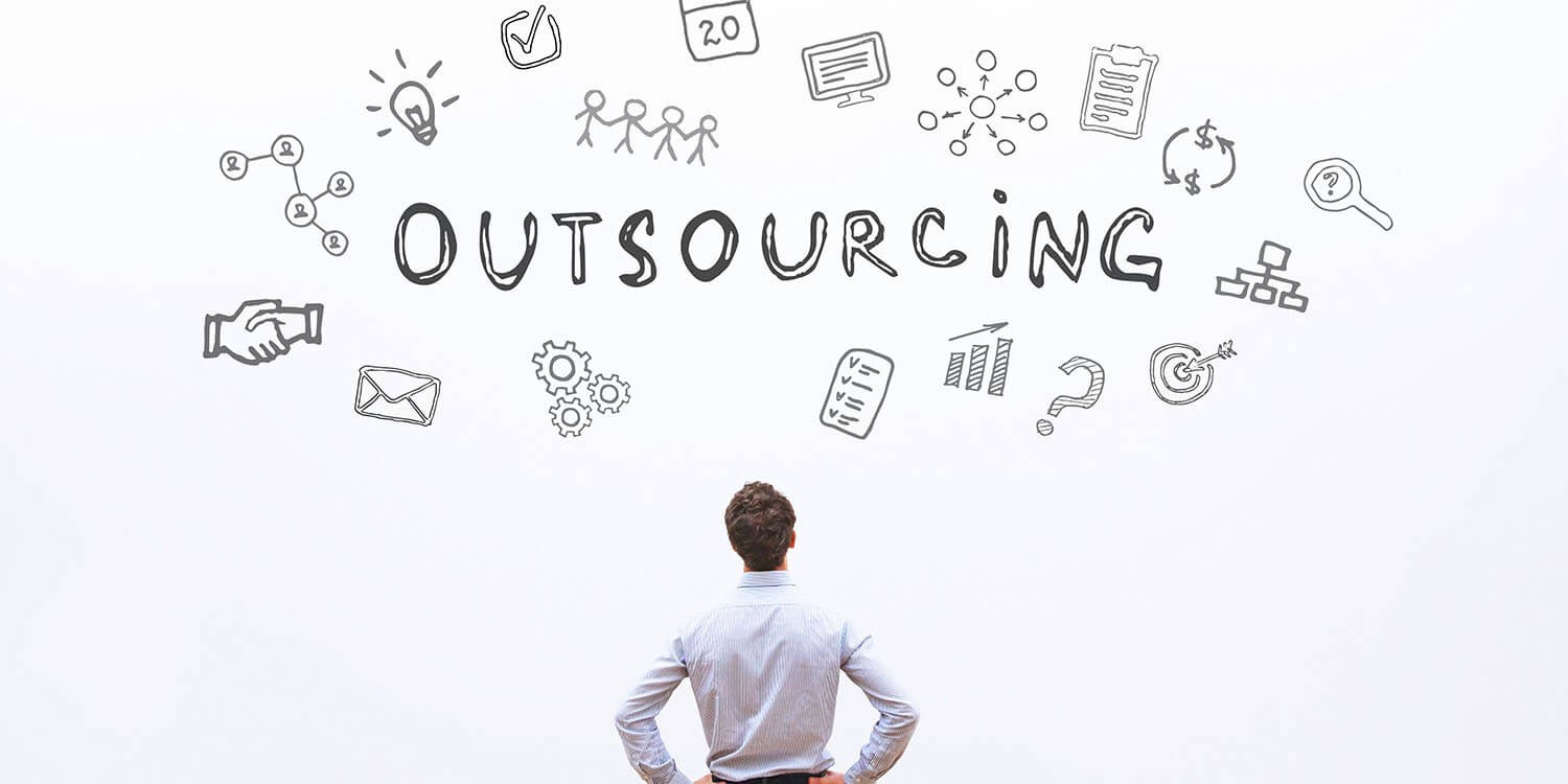 What is outsourcing, and how does it work?