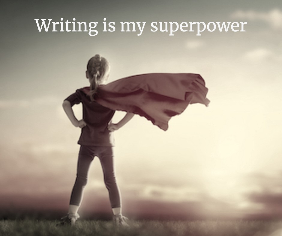 a child wearing a red superhero cape, with words Writing is my superpower