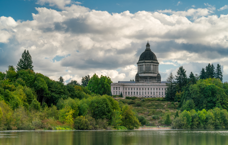 An image of the Washington State Capitol Building and Temple of Justice with Capital Lake in the foreground.