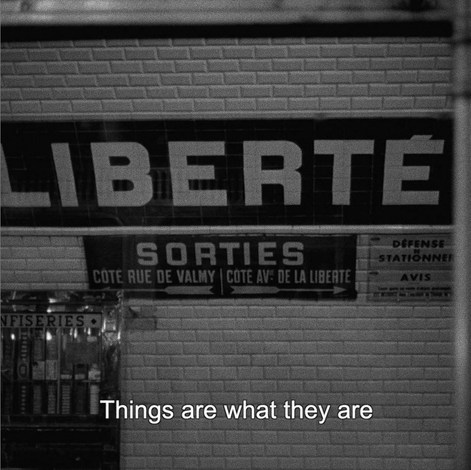 "Screen shot from Bande à part (1964) by Jean-Luc Godard. Image of French signs in a subway station. Subtitle says, ""Things are what they are."""