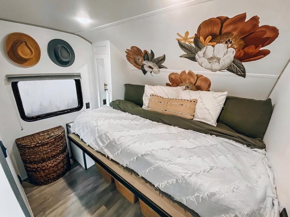 The bedroom of the couple's toy hauler.