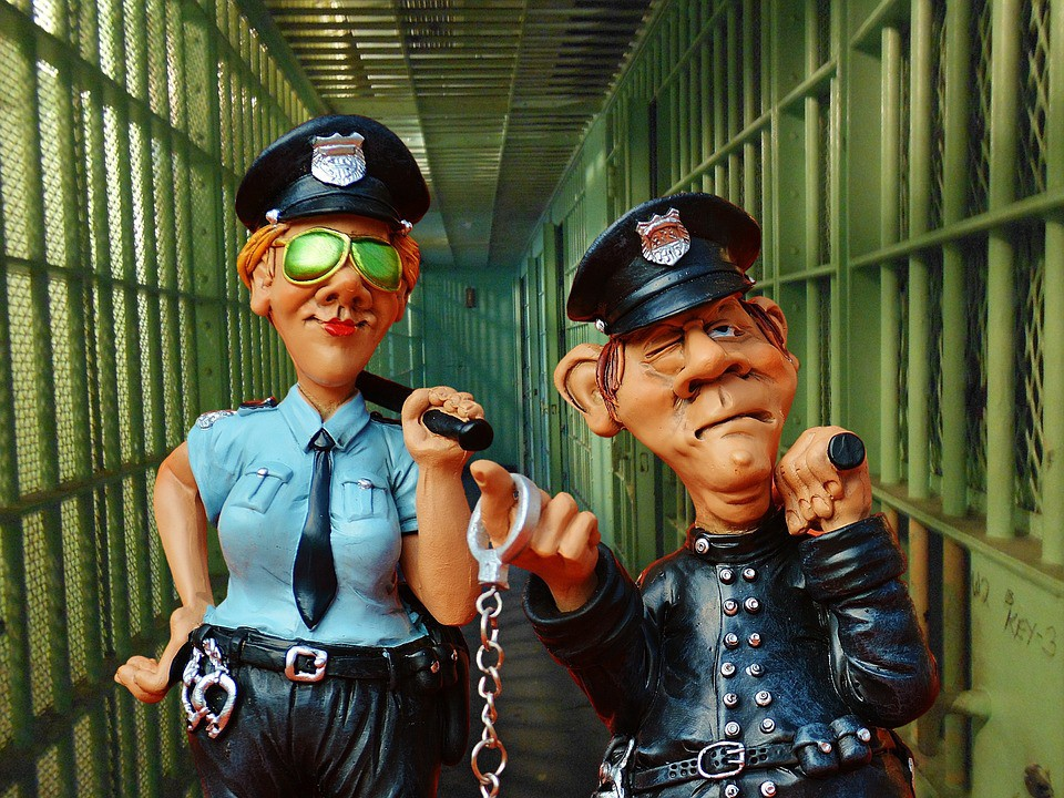 Caricature of man and woman prison guards.