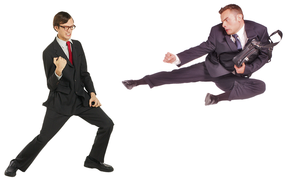 Two business men in suites fighting with each other
