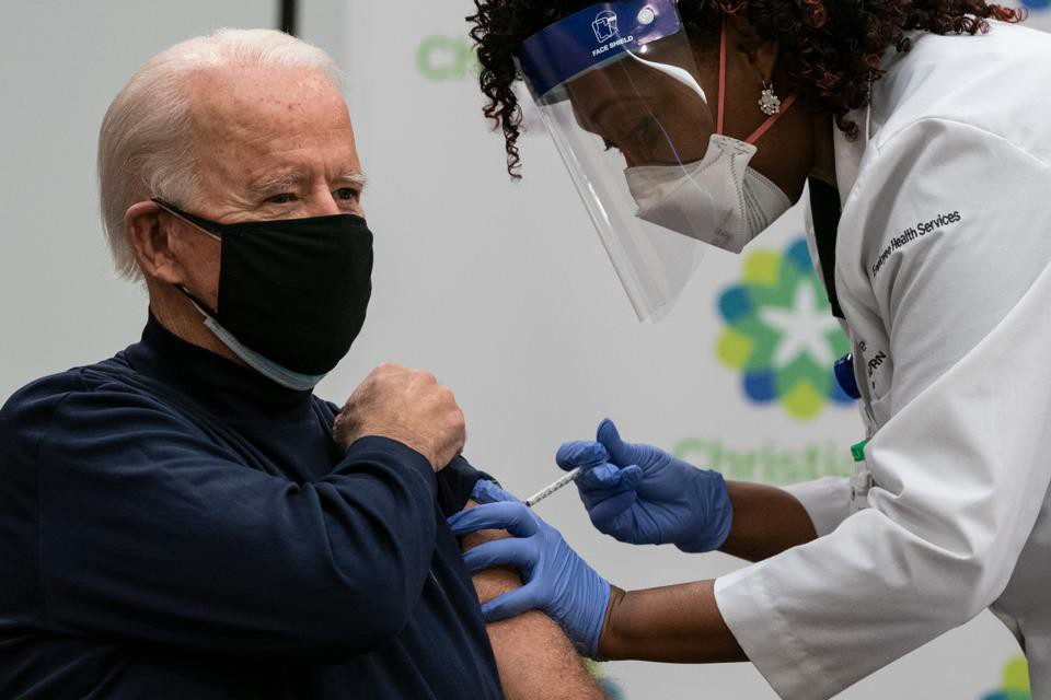 US President-elect Joe Biden receives a COVID-19 vaccination from Tabe Mase, Nurse Practitioner and Head of Employee Health S