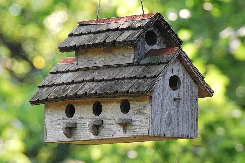 A big birdhouse with many entrances