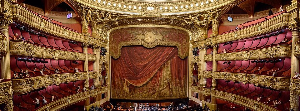 View of gilded, red-curtained stage.