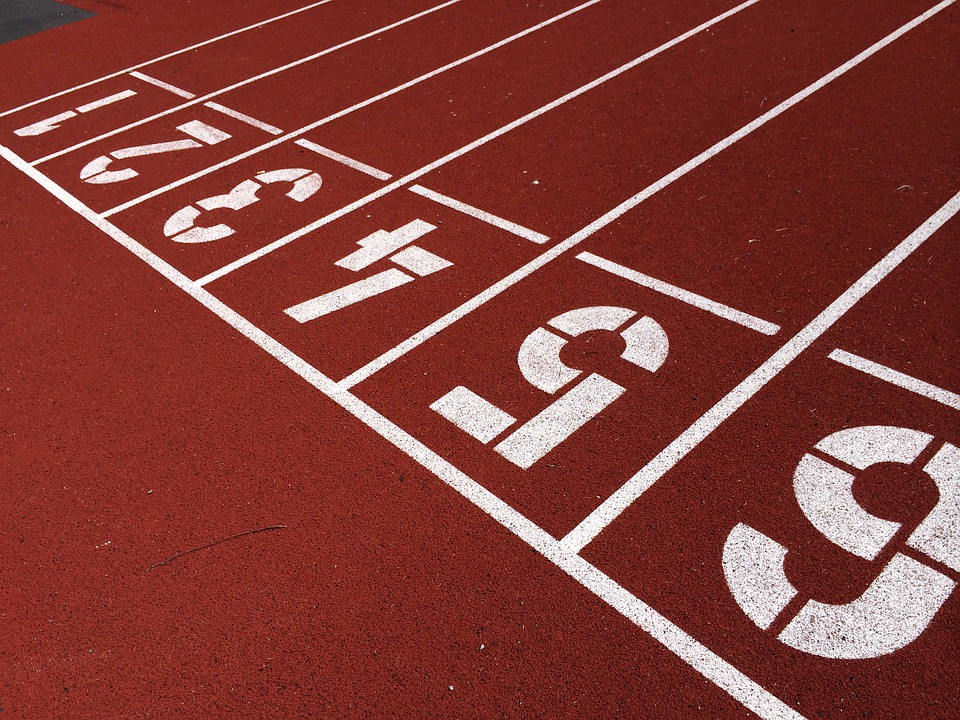 Close-up, oblique view of a running track.