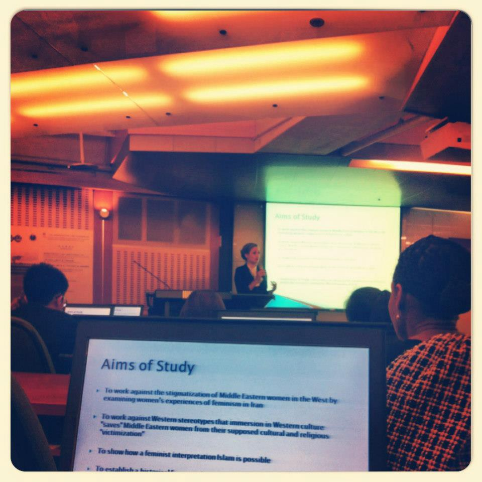 The author defending her Master's thesis in Taipei, Taiwan.