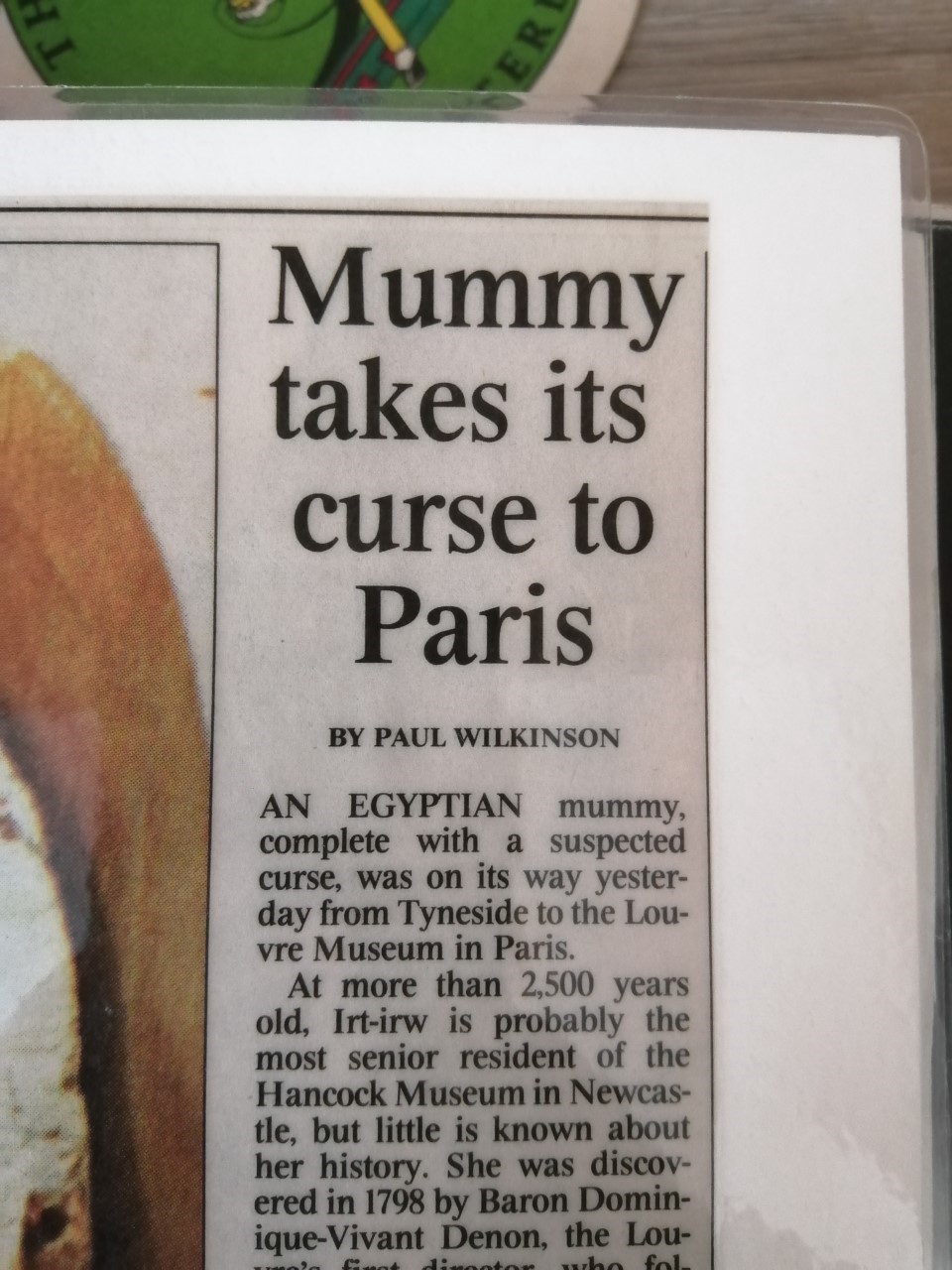 """Newspaper article reading """"Mummy takes its curse to Paris. An Egyptian mummy, complete with a suspected curse, was on its way yesterday from Tyneside to the Louvre Museum in Paris."""""""
