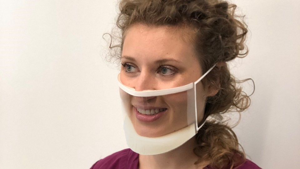Lady wearing ClearMask, a mask which allows Deaf people to see the persons mouth.