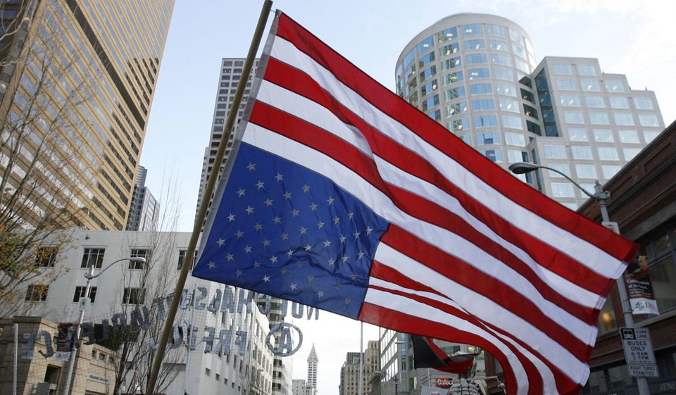 A flag flying upside down. A symbol of dire distress. Image The Seattle Times.