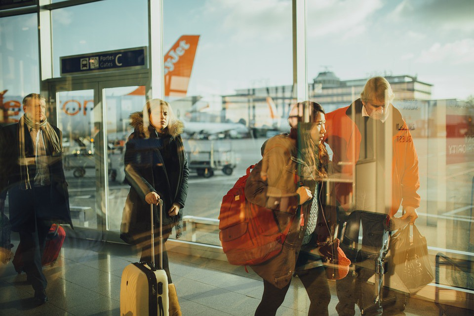 Passengers about to board a plane at the airport