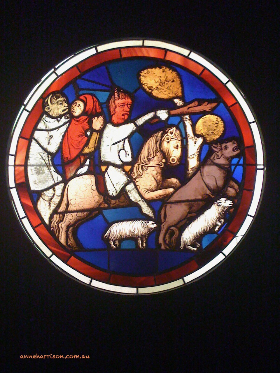 A medieval stained glass window showing Death on a horse