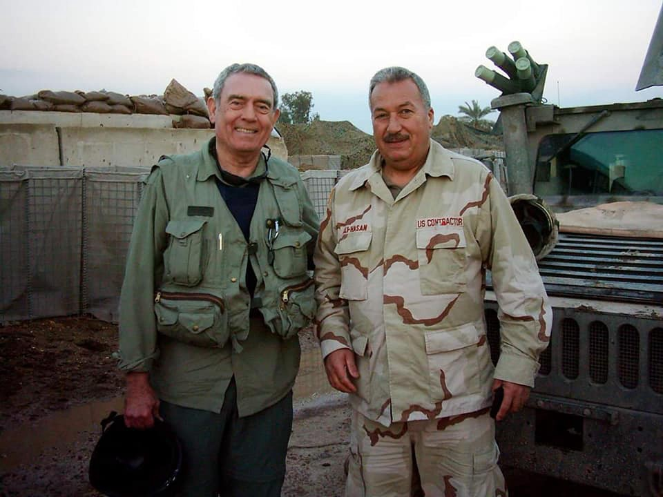 My father in army fatigues posing with veteran journalist Dan Rather at a military base in Iraq.