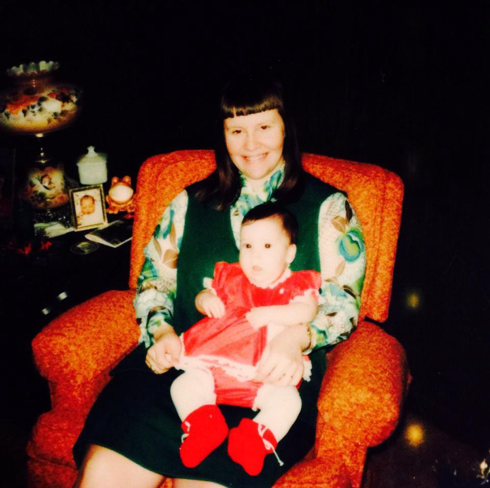 An older photo of a mother and her infant daughter.