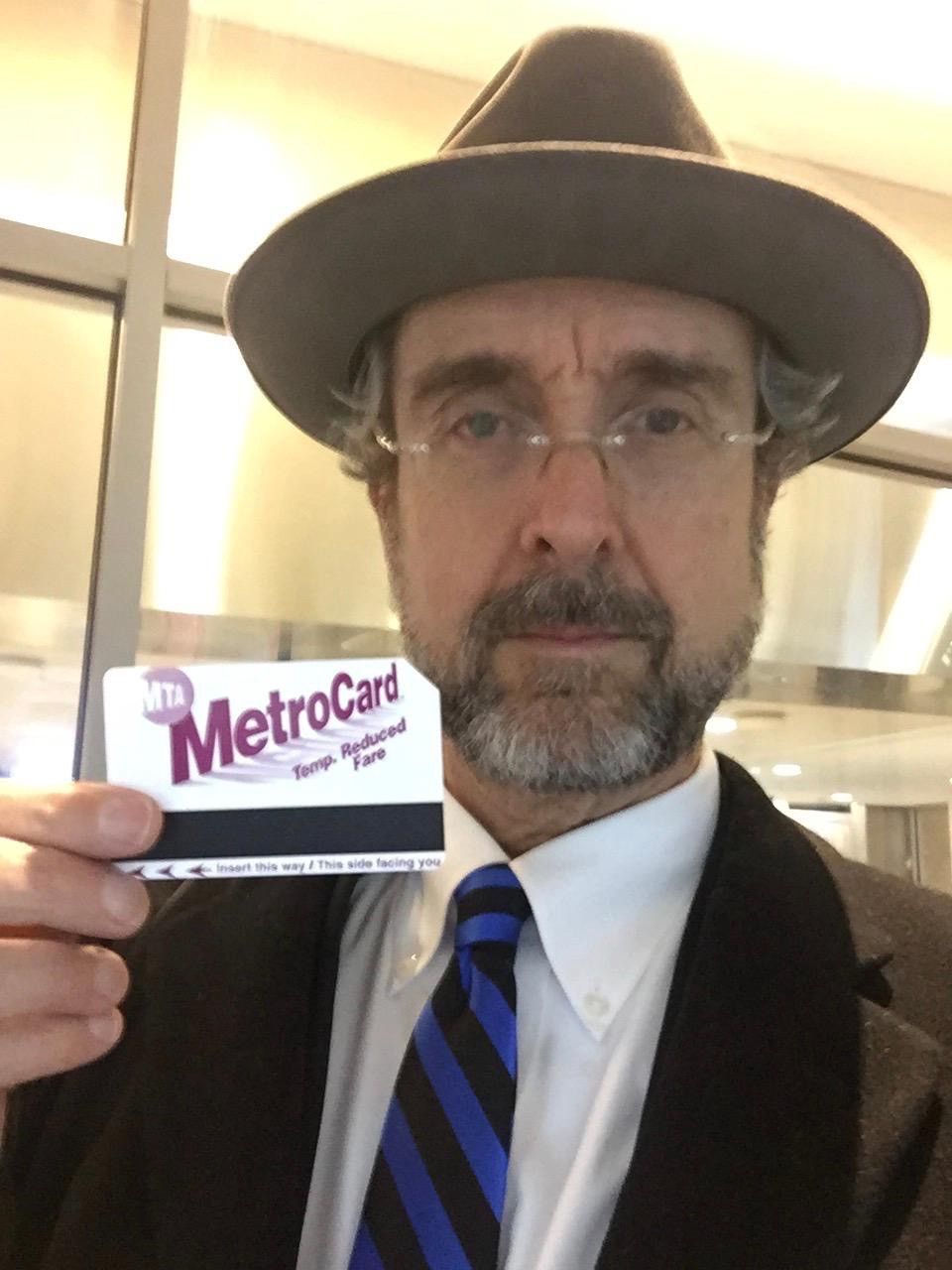 The author approaching 66, with his senior discount subway fare card.