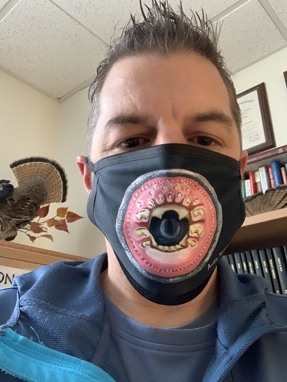 trent sutton in a lamprey mask
