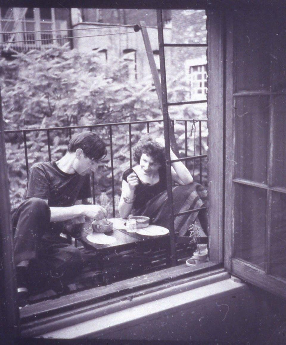 Maya Deren and Alexander Hammid having breakfast on fire escape in Morton Street studio, New York.