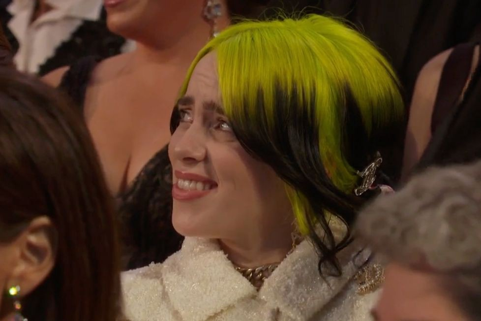Billie Eilish looks horrified and confused by Kristiin Wiig and Maya Rudolph's horrendous onstage singing at the Oscars 2020
