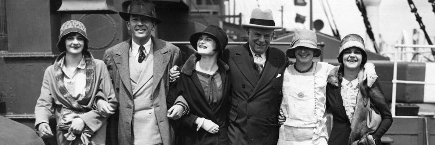 Group of people walking in unison 1920s clothing and style