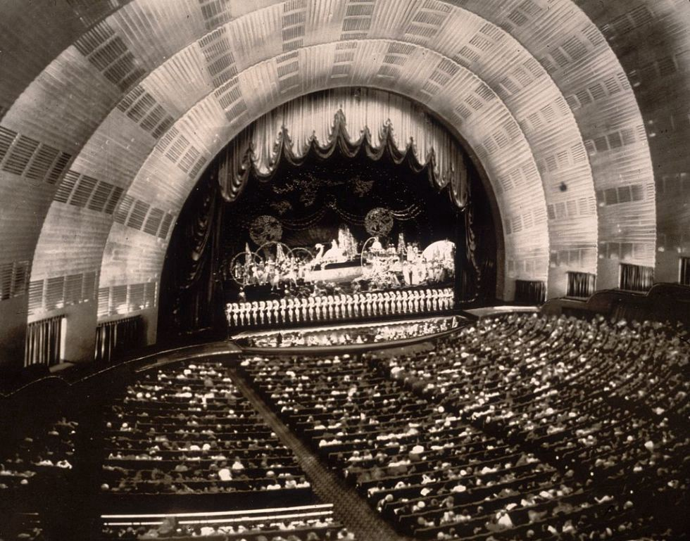 Roxy is credited with dreaming up the radiant sunrise stage that makes Radio City Music Hall so iconic today.