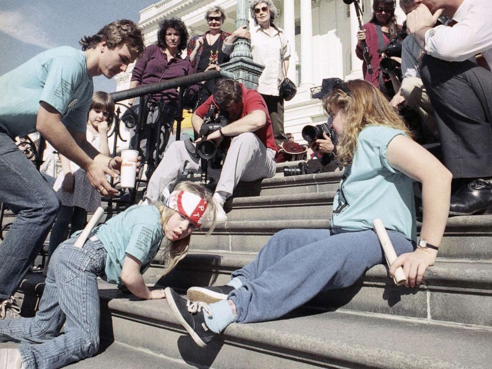 Picture from the original ADA protests of protesters crawling up a set of stairs at the Capitol building