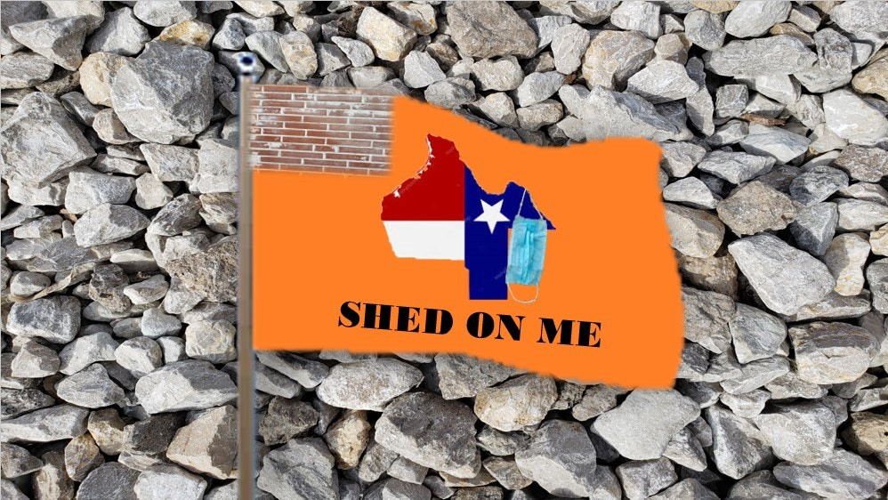 An orange flag on a bed of rocks, with a canton of bricks, shows Texas upside down with a dangling mask, and the motto Shed on Me.