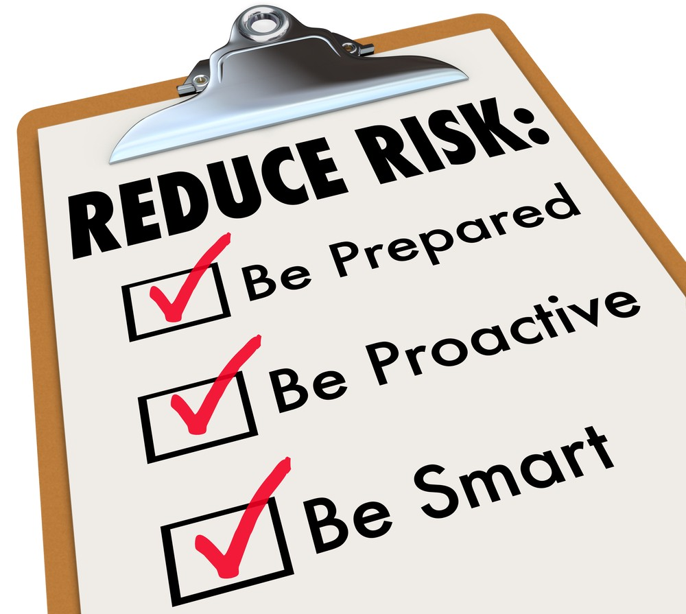 Reduce Risk words on clipboard with checkmarks for Be Prepared, Proactive and Smart to illustrate increasing safety and security through careful planning towards career mobility.