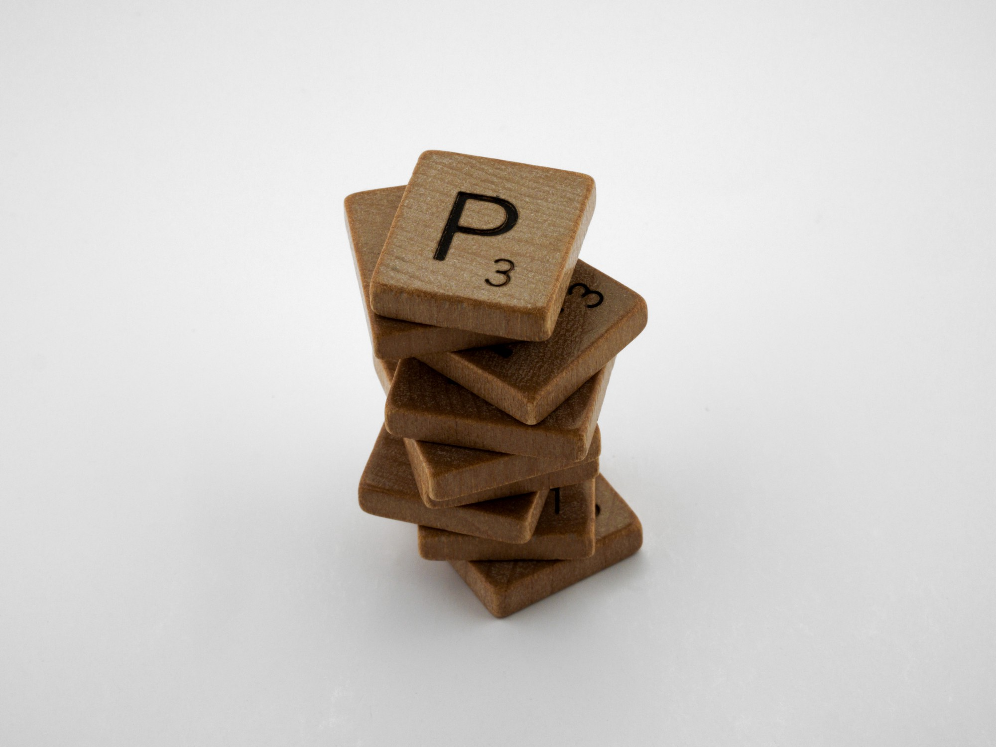 Stack of 8 Scrabble tiles with P3 showing on top