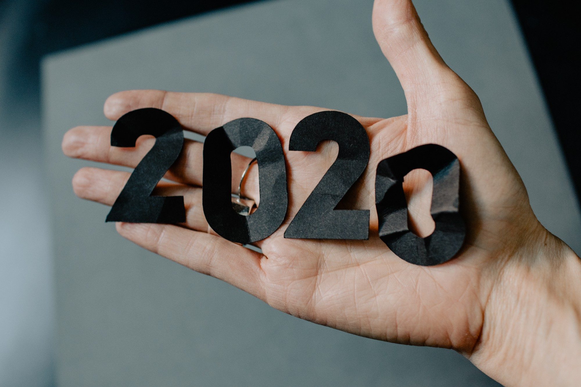 Paper cutout of 2020 in person's hand