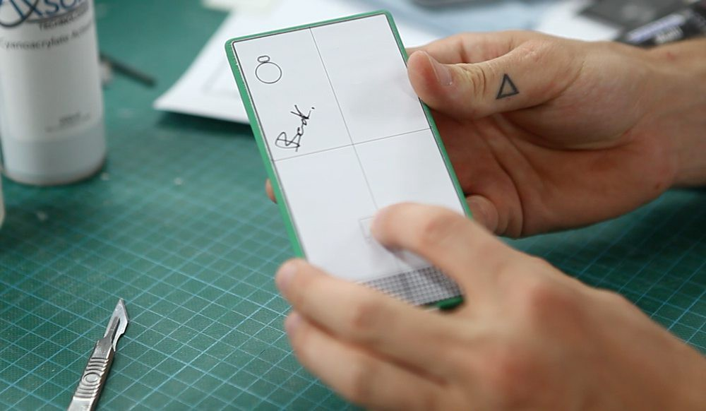 A Fairphone employee with a makeshift prototype