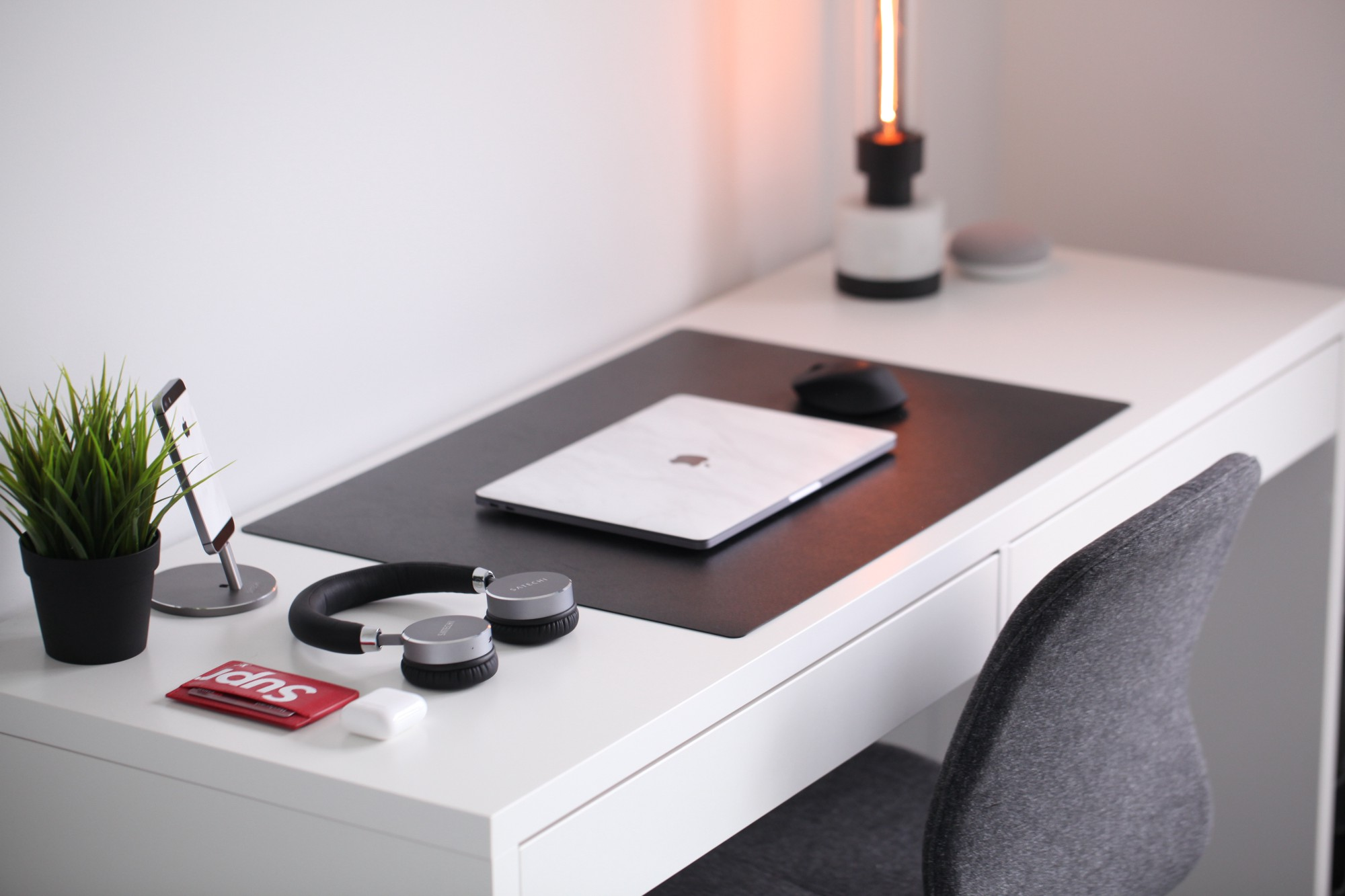 a simple desk with a laptop